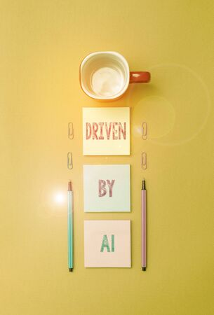 Text sign showing Driven By A1. Business photo text Move or controlled by a top quality driver in the society Coffee cup blank colored sticky note two ballpoints clips yolk background