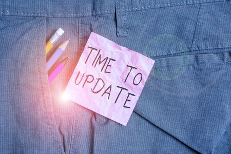 Text sign showing Time To Update. Business photo text The latest information about a particular situation Writing equipment and pink note paper inside pocket of man work trousers