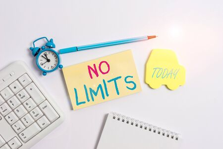 Word writing text No Limits. Business photo showcasing to do whatever you could with out restrictions and holding back Copy space on empty note paper with clock and pencil on the table Stock Photo