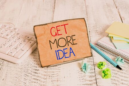 Conceptual hand writing showing Get More Idea. Concept meaning Random Input Mind Map Picture Mock up Surveys Visualization Notepaper on wire in between computer keyboard and sheets Zdjęcie Seryjne