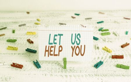 Handwriting text writing Let Us Help You. Conceptual photo Offering a service to someone to help him in his necessity Green clothespin white wood background colored paper reminder office supply