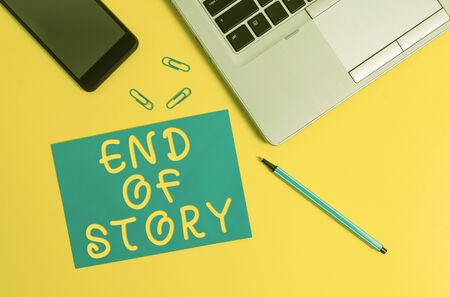 Conceptual hand writing showing End Of Story. Concept meaning Emphasize that nothing to add Literature writing Journalism Trendy open laptop smartphone marker paper sheet clips