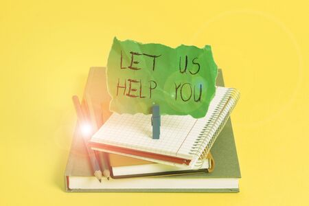 Text sign showing Let Us Help You. Business photo showcasing Offering a service to someone to help him in his necessity Book pencil rectangle shaped reminder notebook clothespin office supplies