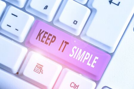 Writing note showing Keep It Simple. Business concept for Remain in the simple place or position not complicated Stock Photo
