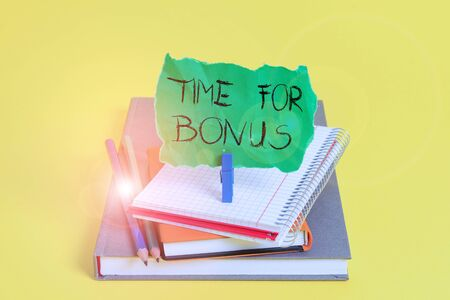 Text sign showing Time For Bonus. Business photo showcasing a sum of money added to a demonstrating s is wages as a reward Book pencil rectangle shaped reminder notebook clothespin office supplies
