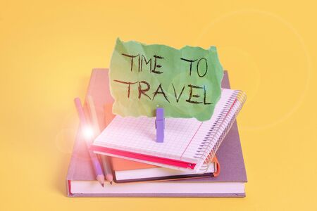 Text sign showing Time To Travel. Business photo showcasing Moving or going from one place to another on vacation Book pencil rectangle shaped reminder notebook clothespin office supplies