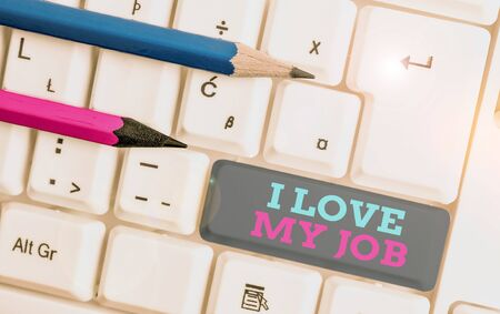 Conceptual hand writing showing I Love My Job. Concept meaning Enjoying the daily tasked assigned Contented on the occupation White pc keyboard with note paper above the white background Stock fotó