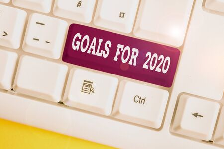 Word writing text Goals For 2020. Business photo showcasing The following things you want to have and achieve in 2020 White pc keyboard with empty note paper above white background key copy space