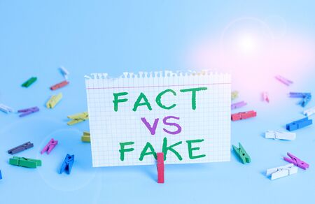Word writing text Fact Vs Fake. Business photo showcasing Rivalry or products or information originaly made or imitation Colored clothespin rectangle square shaped paper light blue background