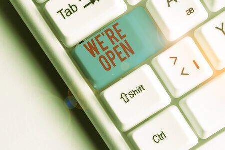 Writing note showing We Re Open. Business concept for answering on client that shop is available at this time