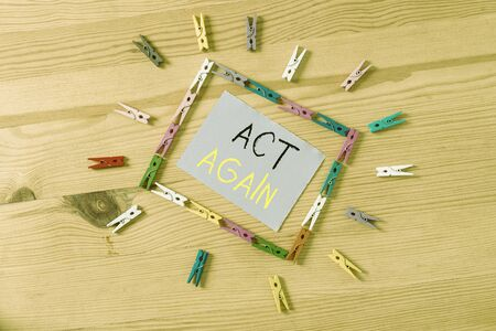 Word writing text Act Again. Business photo showcasing do something for a particular purpose Take action on something Colored clothespin papers empty reminder wooden floor background office Stock Photo