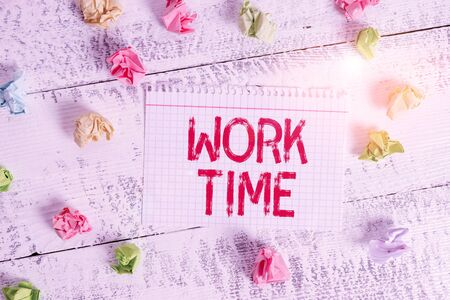 Handwriting text writing Work Time. Conceptual photo period starts when temporary workers are engaged at a worksite Crumpled colored rectangle square shaped paper reminder white wood desk