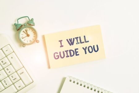 Conceptual hand writing showing I Will Guide You. Concept meaning Help showing a route Influence to do or think something Keyboard with empty note paper and pencil white background