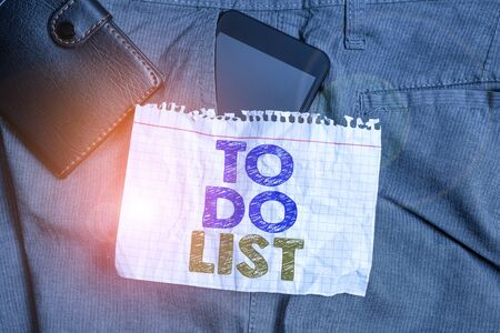 Word writing text To Do List. Business photo showcasing A structure that usualy made in paper contining task of yours Smartphone device inside trousers front pocket with wallet and note paper