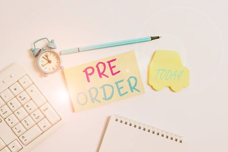Word writing text Pre Order. Business photo showcasing an order for a product placed before it is available for purchase Copy space on empty note paper with clock and pencil on the table Stockfoto