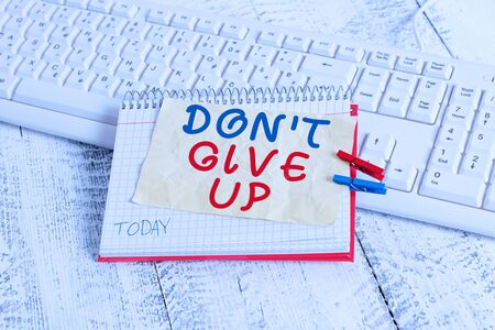 Conceptual hand writing showing Don T Give Up. Concept meaning Determined Persevering Continue to Believe in Yourself notebook reminder clothespin with pinned sheet light wooden Stock fotó