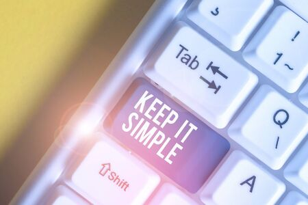 Conceptual hand writing showing Keep It Simple. Concept meaning Remain in the simple place or position not complicated White pc keyboard with note paper above the white background Stock Photo