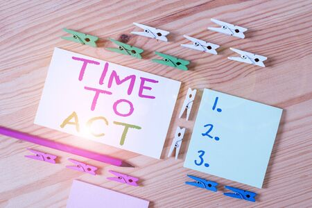 Text sign showing Time To Act. Business photo showcasing Do it now Response Immediately Something need to be done Colored clothespin papers empty reminder wooden floor background office