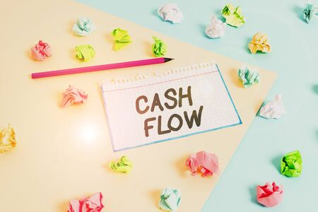 Word writing text Cash Flow. Business photo showcasing Movement of the money in and out affecting the liquidity Colored crumpled papers empty reminder blue yellow background clothespin