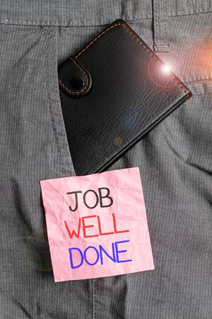 Text sign showing Job Well Done. Business photo text Well Performed You did it Cheers Approval Par Accomplished Small little wallet inside man trousers front pocket near notation paper 写真素材