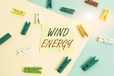 Word writing text Wind Energy. Business photo showcasing the process by which wind is used to generate electricity Colored clothespin paper empty reminder yellow blue floor background office