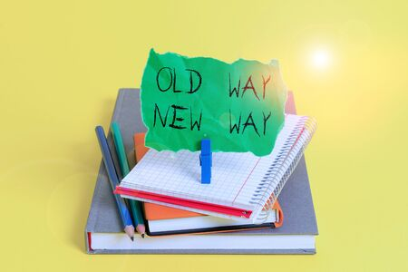 Text sign showing Old Way New Way. Business photo showcasing The different way to fulfill the desired purposes Book pencil rectangle shaped reminder notebook clothespin office supplies Zdjęcie Seryjne - 134162657