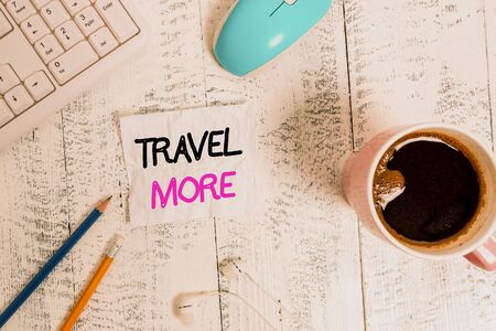 Handwriting text writing Travel More. Conceptual photo To make a journey often especially on long distance trip technological devices colored reminder paper office supplies keyboard mouse Фото со стока