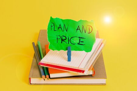 Text sign showing Plan And Price. Business photo showcasing setting decent price for product to sale according market Book pencil rectangle shaped reminder notebook clothespin office supplies