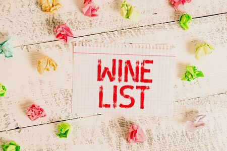 Handwriting text writing Wine List. Conceptual photo menu of wine selections for purchase typically in a restaurant Crumpled colored rectangle square shaped paper reminder white wood desk