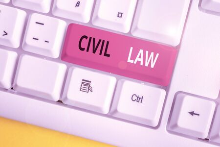 Conceptual hand writing showing Civil Law. Concept meaning Law concerned with private relations between members of community White pc keyboard with note paper above the white background