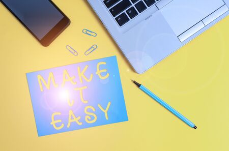Conceptual hand writing showing Make It Easy. Concept meaning Smart approach Effortless Free from worries or difficulties Trendy open laptop smartphone marker paper sheet clips