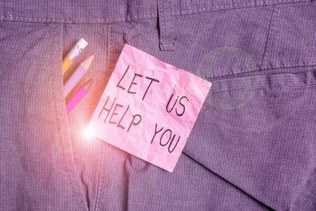 Text sign showing Let Us Help You. Business photo text Offering a service to someone to help him in his necessity Writing equipment and pink note paper inside pocket of man work trousers