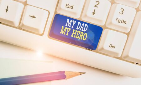 Writing note showing My Dad My Hero. Business concept for Admiration for your father love feelings emotions compliment White pc keyboard with note paper above the white background 写真素材