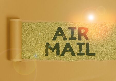 Text sign showing Air Mail. Business photo text the bags of letters and packages that are transported by aircraft Cardboard which is torn in the middle placed above a wooden classic table