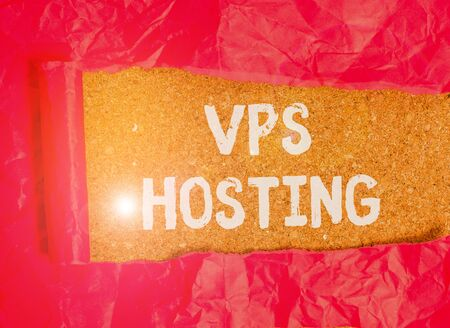 Handwriting text Vps Hosting. Conceptual photo mimics a dedicated server within a shared hosting environment Cardboard which is torn in the middle placed above a wooden classic table Banco de Imagens