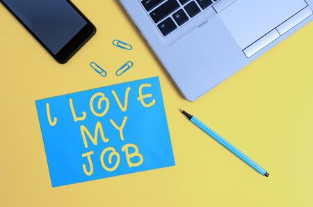 Conceptual hand writing showing I Love My Job. Concept meaning Enjoying the daily tasked assigned Contented on the occupation Trendy open laptop smartphone marker paper sheet clips
