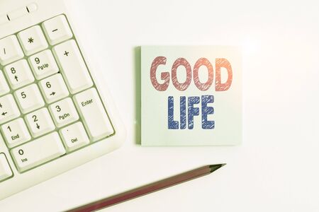 Handwriting text Good Life. Conceptual photo living in comfort and luxury with few problems or worries White pc keyboard with empty note paper and pencil above white background