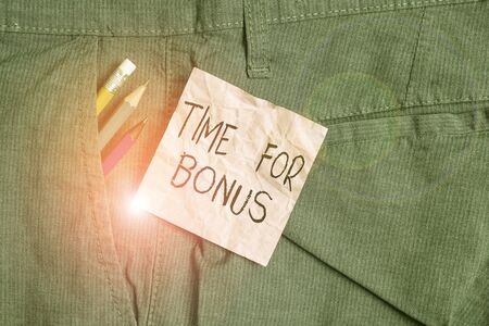 Text sign showing Time For Bonus. Business photo text a sum of money added to a demonstrating s is wages as a reward Writing equipment and pink note paper inside pocket of man work trousers