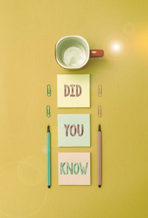 Text sign showing Did You Know. Business photo text Knowing the next move Thinking Trivia Brainstorming Wondering Coffee cup blank colored sticky note two ballpoints clips yolk background
