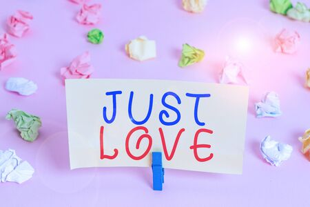 Word writing text Just Love. Business photo showcasing being interested physically in someone An emotional attachment Colored crumpled papers empty reminder pink floor background clothespin