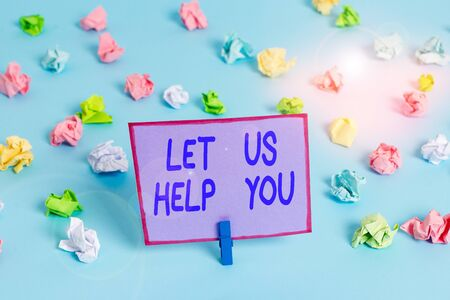 Conceptual hand writing showing Let Us Help You. Concept meaning Offering a service to someone to help him in his necessity Colored crumpled papers empty reminder blue floor clothespin 版權商用圖片