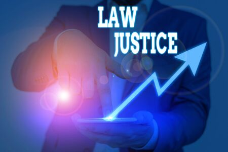 Conceptual hand writing showing Law Justice. Concept meaning a scheme or system of law in which every demonstrating receives