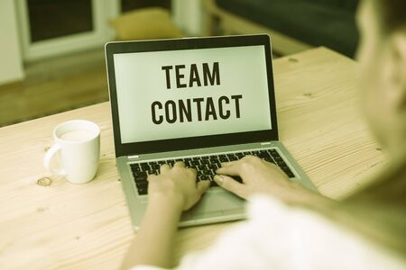 Writing note showing Team Contact. Business concept for The interaction of the individuals on a team or group woman with laptop smartphone and office supplies technology