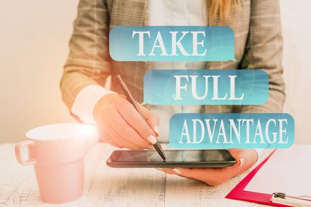 Writing note showing Take Full Advantage. Business concept for Utilize someone or something to the fullest extent Business concept with mobile phone in the hand