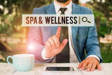 Handwriting text writing Spa And Wellness. Conceptual photo Place where showing go to improve their health Relaxation Businessman with pointing finger in front of him
