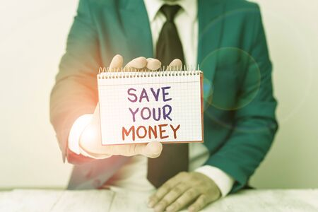 Conceptual hand writing showing Save Your Money. Concept meaning keep your savings in bank or stock to protect it Dont waste Man holds empty paper with copy space in front of him Space