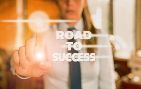 Word writing text Road To Success. Business photo showcasing studying really hard Improve yourself to reach dreams wishes Blurred woman in the background pointing with finger in empty space Standard-Bild