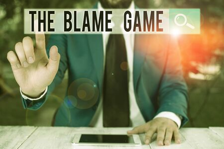 Conceptual hand writing showing The Blame Game. Concept meaning A situation when showing attempt to blame one another Businessman with pointing finger in front of him