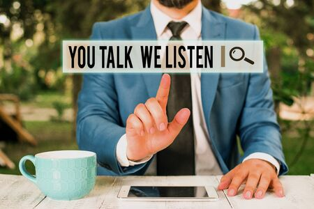 Handwriting text writing You Talk We Listen. Conceptual photo Two Way Communication Motivational Conversation Businessman with pointing finger in front of him