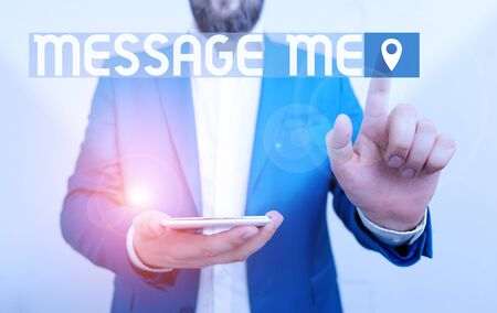 Handwriting text writing Message Me. Conceptual photo To ask someone to send you a short text from one mobile device Businessman in the blue suite with lap top pointing with finger Stock fotó